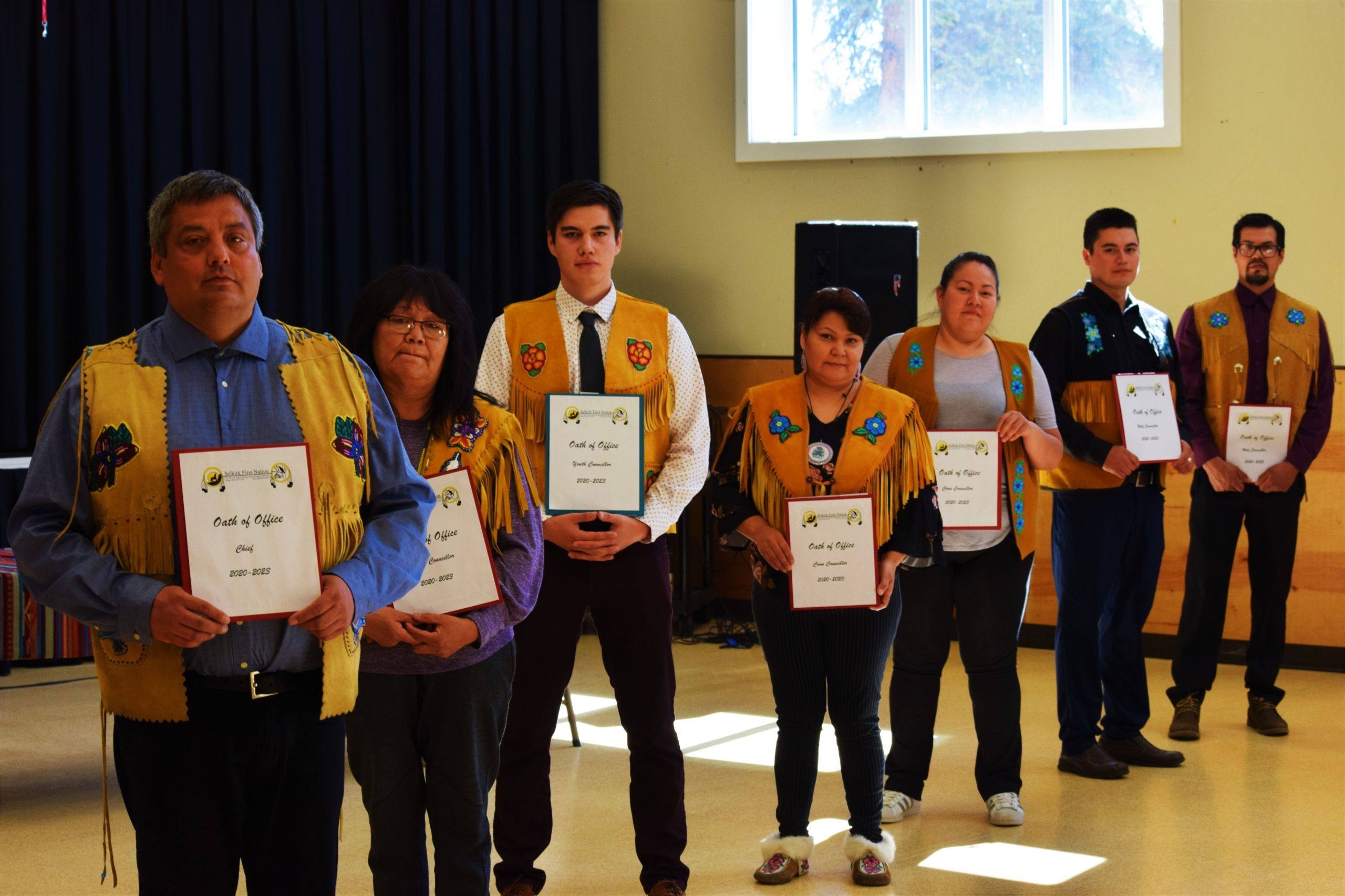 Left to Right: Chief Darin Isaac, Elder Councillor Amy Johnnie, Youth Councillor Cody Sims, Crow Councillor Carmen Baker, Crow Councillor Ashley Edzerza, Wolf Councillor Morris Morrison and Wolf Councillor Jeremy Harper